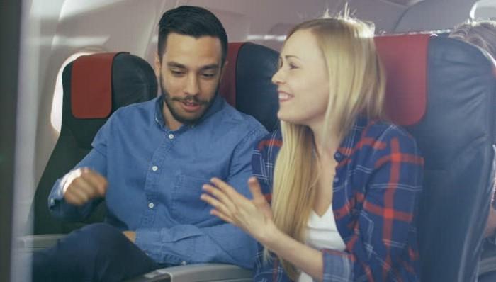 Image of conversation on plane