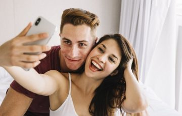 Image of couple taking selfie